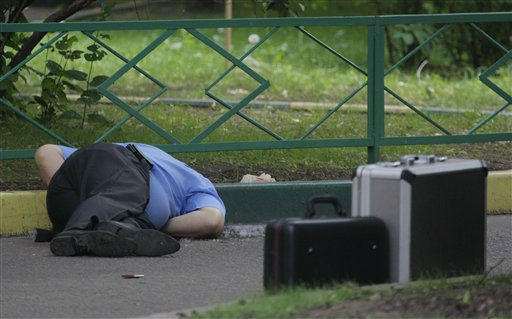 The body of former Russian army Colonel Yuri Budanov, convicted of murdering a teenage Chechen woman, lies on the ground in Moscow, Russia, Friday, June 10, 2011, where according to investigators he was gunned down. Budanov was convicted in 2003 of murdering 18-year-old Heda Kungayeva in 2000. He said he strangled her in a fit of rage, believing her to be a rebel sniper. He was released on parole in early 2009 after serving nine years of his 10-year sentence&#40;AP Photo&#47;Mikhail Metzel&#41; <span class=meta>(AP Photo&#47; Mikhail Metzel)</span>