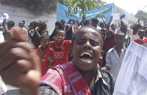 "<div class=""meta image-caption""><div class=""origin-logo origin-image ""><span></span></div><span class=""caption-text"">A protester shouts slogan in Mogadishu, Somalia, Friday, June 10, 2011, where protesters took to the streets for the second day in support of current Prime Minister Mohamed Abdullahi Farmajo. A new accord extending the government's term by a year requires Prime Minister Mohamed Abdullahi Mohamed to resign in a month, but  Mohamed is popular with many Somalis because he has managed to pay salaries for government workers and soldiers and attack corruption since he came to power in October last year. (AP Photo/Mohamed Sheikh Nor)         ? (AP Photo/ Mohamed Sheikh Nor)</span></div>"