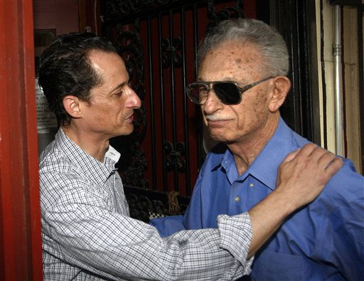 US Congressman Anthony Weiner D-NY, left, leaves his home in New York going to the local laundromat, taking money out of an ATM machine and saying hello at a real estate office before returning to his apartment he also received greetings and support from people on the street Saturday, June  11, 2011  &#40;AP Photo&#47;David Karp&#41; <span class=meta>(AP Photo&#47; DAVID KARP)</span>