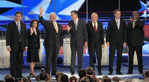 From left, former Pennsylvania Sen. Rick Santorum, Rep. Michele Bachmann, R-Minn., former House Speaker Newt Gingrich, former Massachusetts Gov. Mitt Romney, Rep. Ron Paul, R-Texas, former Minnesota Gov. Tim Pawlenty and businessman Herman Cain stand on stage before first New Hampshire Republican presidential debate at St. Anselm College in Manchester, N.H., Monday, June 13, 2011. &#40;AP Photo&#47;Jim Cole&#41; <span class=meta>(AP Photo&#47; Jim Cole)</span>