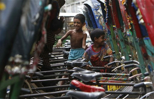 Children play amid parked cycle rickshaws during the last day of the 36-hour nationwide strike called by the opposition in Dhaka, Bangladesh, Monday, June 13, 2011. Protesters set a bus on fire and smashed several vehicles Monday on the second day of a general strike against government moves to amend the constitution, news reports said. &#40;AP Photo&#47;Pavel Rahman&#41; <span class=meta>(AP Photo&#47; Pavel Rahman)</span>
