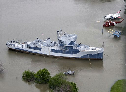 The World War II minesweeper USS Hazard, normally on dry ground while on display at Omaha&#39;s Freedom Park, is once again in water, Tuesday, June 14, 2011, as the rising waters of the Missouri River flood the grounds. On Tuesday, the releases at Gavins Point Dam in South Dakota hit the maximum planned amount of 150,000 cubic feet of water per second, which are expected to raise the Missouri River 5 to 7 feet above flood stage in most of Nebraska and Iowa. &#40;AP Photo&#47;Nati Harnik&#41; <span class=meta>(AP Photo&#47; Nati Harnik)</span>