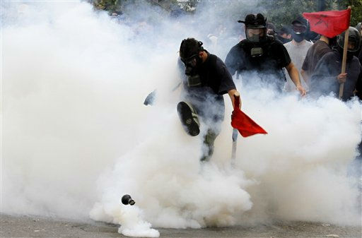 "<div class=""meta image-caption""><div class=""origin-logo origin-image ""><span></span></div><span class=""caption-text"">Demonstrator kicks away tear gas canister outside the Parliament in central Athens, during a rally against plans for new austerity measures,  Wednesday, June 15, 2011. A 24-hour strike by Greece's largest labor unions is set to cripple public services Wednesday, as the Socialist government begins a legislative battle to push through last-ditch cost cutting reforms that will exceed its own term in office.Demonstrators had camped outside parliament since May 25, 2011. AP Photo/Kostas Tsironis) (AP Photo/ Kostas Tsironis)</span></div>"