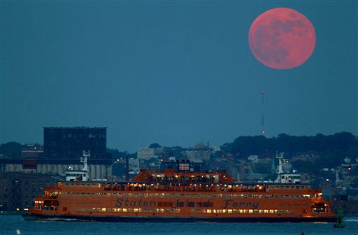 The Staten Island Ferry cruises along the water as the moon rises over Brooklyn as seen from Liberty State Park, Wednesday, June 15, 2011 in Jersey City, N.J. &#40;AP Photo&#47;Julio Cortez&#41; <span class=meta>(AP Photo&#47; Julio Cortez)</span>