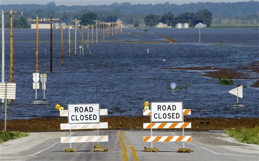 Flood waters from the nearby Missouri River cover a county highway, Wednesday, June 15, 2011, in Hamburg, Iowa.  The water level continues to rise and officials say that it should crest sometime later this week. &#40;AP Photo&#47;Charlie Neibergall&#41; <span class=meta>(AP Photo&#47; Charlie Neibergall)</span>