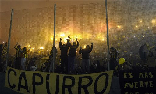 "<div class=""meta image-caption""><div class=""origin-logo origin-image ""><span></span></div><span class=""caption-text"">Uruguay's Penarol soccer fans cheer for their team at the start of the Copa Libertadores final first leg match with Brazil's Santos in Montevideo, Uruguay, Wednesday June 15, 2011. (AP Photo/Matilde Campodonico) (AP Photo/ Matilde Campodonico)</span></div>"