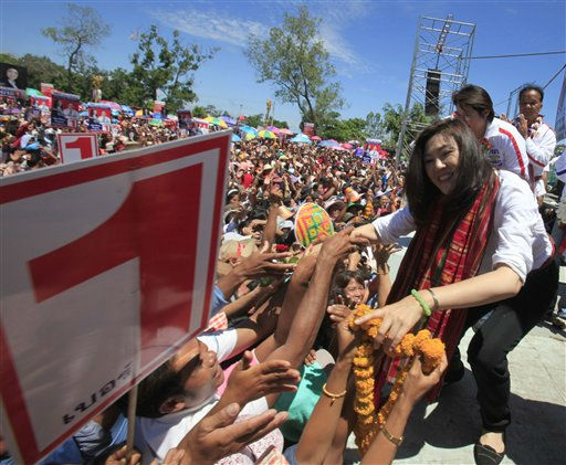 In this picture taken on June 15, 2011, Yingluck Shinawatra, right, opposition Pheu Thai Party&#39;s candidate for prime minister and sister of ousted Prime Minister Thaksin Shinawatra, is greeted by her supporters during an election campaign for her party in Ubonratchathani province, northeast of Bangkok, Thailand. Yingluck Shinawatra, who could become Thailand&#39;s first female prime minister, kicks off every choreographed campaign stop asking electrified crowds if they miss her brother, a billionaire ex-premier overthrown by the military five years ago. &#40;AP Photo&#47;Sakchai Lalit&#41; <span class=meta>(AP Photo&#47; Sakchai Lalit)</span>