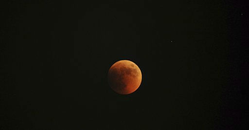 The moon turns red during a total lunar eclipse, as seen from Skopje, Macedonia, on Wednesday, June 15, 2011. &#40;AP Photo&#47;Boris Grdanoski&#41; <span class=meta>(AP Photo&#47; BORIS GRDANOSKI)</span>