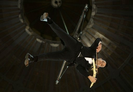 Violinist Shenzo Gregorio performs while strapped into a trapeze in the Queen Victoria Building in Sydney, Thursday, June 16, 2011.  Gregorio plays to shoppers on three levels while he is suspended up to 25 meters &#40;82 feet&#41; in the air. &#40;&#40;AP Photo&#47;Rick Rycroft&#41; <span class=meta>(AP Photo&#47; Rick Rycroft)</span>