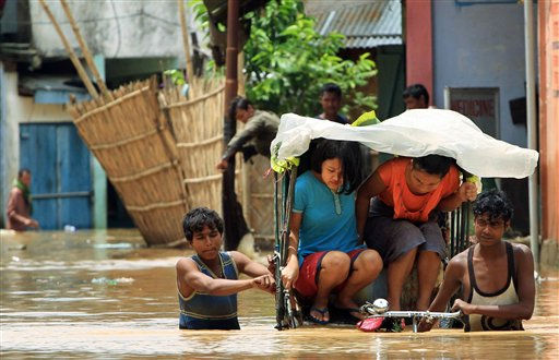 A rickshaw puller wades through a water-logged street due to heavy rain in Dimapur in northeastern Indian state of Nagaland, Friday, June 17, 2011. &#40;AP Photo&#47;Sorei Mahong&#41; <span class=meta>(AP Photo&#47; Sorei Mahong)</span>