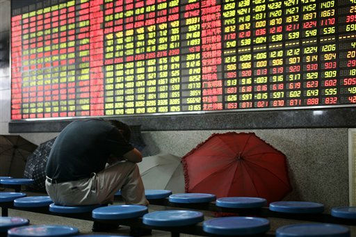 "<div class=""meta image-caption""><div class=""origin-logo origin-image ""><span></span></div><span class=""caption-text"">An investor reacts as he looks at the stock price board at a private securities company Friday June 17, 2011 in Shanghai, China. Mainland Chinese shares fell to their lowest level so far this year as investors reacted to news of a rise in the rate for Chinese central bank's three-month bills on Thursday, seen as a cue that an interest rate hike may be in the offing. (AP Photo) (AP Photo/ STR)</span></div>"