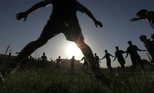 In this June 18, 2011 photo,  hopeful Afghan rugby players exercise in a field hockey venue, alongside Kabul&#39;s Olympic Stadium, the same arena the Taliban used to cut off the hands of thieves and hold executions during their five-year rule in Kabul, Afghanistan.  This is the start of an Afghan national rugby team, a sport still in its infancy in a war-ravaged nation where practices get canceled by Taliban attacks and players get patted down for suicide bomb vests. Organizers and athletes dream of one day being recognized internationally and playing against the greats like South Africa and New Zealand, though they have many pitches to travel before that day.&#40;AP Photo&#47;Gemunu Amarasinghe&#41; <span class=meta>(AP Photo&#47; Gemunu Amarasinghe)</span>