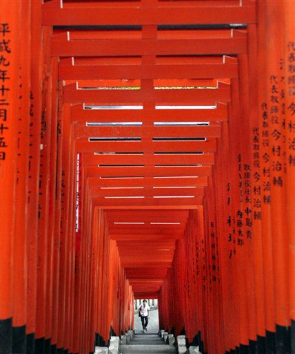A man prepares to walk up stairs at Hie shrine in Tokyo Monday, June 20, 2011. &#40;AP Photo&#47;Koji Sasahara&#41; <span class=meta>(AP Photo&#47; Koji Sasahara)</span>