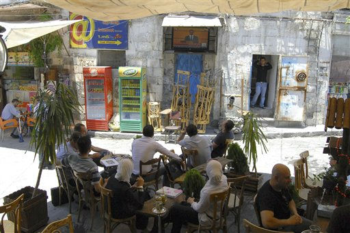 "<div class=""meta ""><span class=""caption-text "">Syrian citizens, sit at a street coffee house to watch Syria's President Bashar Assad deliver a speech on television, in Damascus, Syria, Monday, June 20, 2011. Syria's embattled president says ""saboteurs"" are trying to exploit legitimate demands for reform in the country. President Bashar Assad's speech Monday was only his third public address since the country's uprising began in March. What is happening today has nothing to do with reform, it has to do with vandalism,"" Assad told a crowd of supporters at Damascus University. ""There can be no development without stability, and no reform through vandalism. ... We have to isolate the saboteurs."" (AP Photo/Muzaffar Salman) (AP Photo/ Muzaffar Salman)</span></div>"