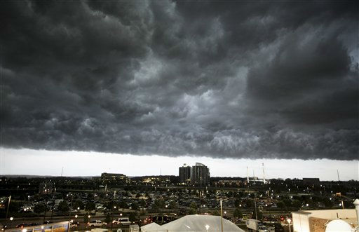 "<div class=""meta ""><span class=""caption-text "">Heavy storm clouds darken the sky as rain and wind gusts blow over downtown Omaha, Neb., Monday, June 20, 2011. (AP Photo/Dave Weaver) (AP Photo/ Dave Weaver)</span></div>"