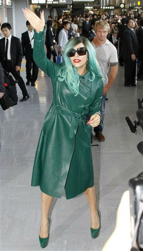 "<div class=""meta ""><span class=""caption-text "">Singer Lady Gaga waves upon arrival at Narita international airport in Narita, east of Tokyo, Tuesday, June 21, 2011. (AP Photo/Koji Sasahara) (AP Photo/ Koji Sasahara)</span></div>"