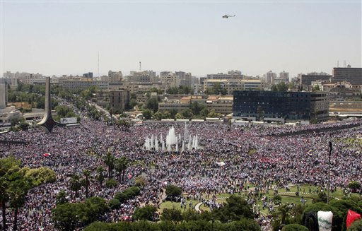 "<div class=""meta image-caption""><div class=""origin-logo origin-image ""><span></span></div><span class=""caption-text"">A helicopter flies overhead, as Syrians rally in support of President Bashar Assad in Damascus, Syria, Tuesday, June 21, 2011. Tens of thousands of people waving flags and pictures of Assad converged on Syria's main squares Tuesday, pledging allegiance to their president in the latest show of government support to counter a three-month uprising against his authoritarian rule. (AP Photo/Bassem Tellawi) (AP Photo/ Bassem Tellawi)</span></div>"