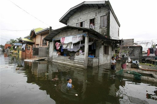 "<div class=""meta image-caption""><div class=""origin-logo origin-image ""><span></span></div><span class=""caption-text"">A boy plays in a flooded street at Malabon, a northern Manila suburb, which was inundated by days of rains brought about by tropical storm Sepat (local name Egay) Tuesday, June 21, 2011. Classes in some schools were suspended after the fifth weather disturbance in the Philippines this year brought heavy rains and flooded low-lying areas of Manila. (AP Photo/Bullit Marquez) (AP Photo/ Bullit Marquez)</span></div>"