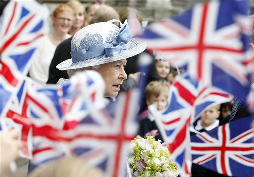 "<div class=""meta ""><span class=""caption-text "">Schoolchildren wave Union flags as Britain's Queen Elizabeth II leaves St Paul's Cathedral in London, Tuesday, June 21, 2011, after attending a service to celebrate its Tercentenary. (AP Photo/Akira Suemori, Pool) (AP Photo/ Akira Suemori)</span></div>"