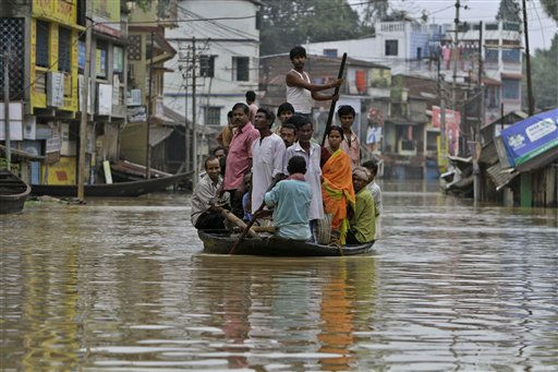 A boat carries people through a flooded street in Ghatal town in West Midnapore, about 100 kilometers &#40;62 miles&#41; northwest of Kolkata, India, Tuesday, June 21, 2011. Monsoon storms in eastern India damaged homes and flooded parts of Kolkata. &#40;AP Photo&#47;Bikas Das&#41; <span class=meta>(AP Photo&#47; Bikas Das)</span>