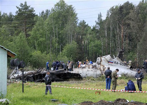 Emergency workers and investigators search a wreckage of Tu-134 plane, belonging to the RusAir airline, near the city of Petrozavodsk Tuesday, June 21, 2011.The passenger jet crashed in heavy fog and burst into flames late Monday on a highway in northwestern Russia, just short of a runway whose fog lights had failed, killing 44 people, officials said. Eight people survived the crash.&#40;AP Photo&#47;Timur Khanov, Komsomolskaya Pravda&#41; <span class=meta>(AP Photo&#47; Timur Khanov)</span>