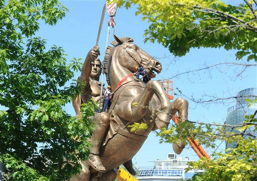 "<div class=""meta ""><span class=""caption-text "">Workers clamber over the statue as they prepare the controversial giant bronze statue of Alexander the Great astride his horse, Bucephalus, in the main square of the capital, Skopje, Tuesday June 21, 2011.  The 28-meter (92-foot) tall monument and fountain officially named ""Warrior on a horse"" cost some euro 9.4 million.  ( US $13.5 million), and claims Alexander the Great as an ancient local hero. (AP Photo/Dragan Perkovski) (AP Photo/ DRAGAN PERKOVSKI)</span></div>"
