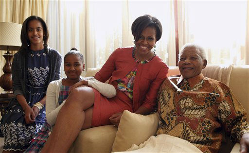 In this photo provided by the Nelson Mandel Foundation on Tuesday, June 21, 2011, US First Lady Michelle Obama centre, accompanied by her daughters, Malia, left and Sasha, meet former South African President Nelson Mandela, at this home, in Houghton, South Africa.  First lady Michelle Obama and her family met with Nelson Mandela during a private visit at the former South African president&#39;s home. Mrs. Obama, daughters Malia and Sasha, and her mother, Marian Robinson, were viewing some of Mandela&#39;s personal papers at his foundation Tuesday when according to White House officials, he sent word that he wanted to meet them. It was Mrs. Obama&#39;s first meeting with the prisoner-turned-president. &#40;AP Photo&#47; Debbie Yazbek, Nelson Mandela Foundation&#41; EDITORIAL USE ONLY <span class=meta>(Photo&#47;Debbie Yazbek)</span>