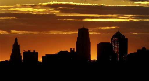 The sun sets behind the Kansas City, Mo. skyline marking the end of the longest day of the year  Tuesday, June 21, 2011 in Kansas City, Mo. &#40;AP Photo&#47;Charlie Riedel&#41; <span class=meta>(AP Photo&#47; Charlie Riedel)</span>