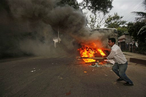 "<div class=""meta ""><span class=""caption-text "">A protestor runs away after setting fire to a government bus in Gauhati, India, Wednesday, June 22, 2011. A protest march held against the eviction of people settled around the hills near Gauhati turned violent Wednesday after police resorted to baton charge and lobbed tear gas shells according to local news reports. (AP Photo/ Anupam Nath) (AP Photo/ Anupam Nath)</span></div>"