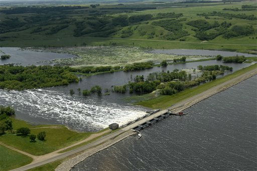 Water flows from Lake Darling into the Souris River on Wednesday, June 22, 2011. Lake Darling is located about fifteen miles north of Minot, ND.  As many as 10,000 people raced to evacuate Wednesday as water began spilling over Minot&#39;s levees. The river, which begins in the Canadian province of Saskatchewan and flows for a short distance though North Dakota, was all but certain to inundate thousands of homes and businesses during the next week. &#40;AP Photo&#47;Will Kincaid&#41; <span class=meta>(AP Photo&#47; WILL KINCAID)</span>