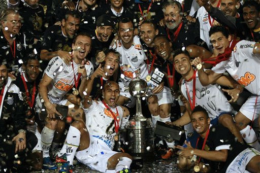 Brazil&#39;s Santos players pose with the Copa Libertadores trophy after defeating Uruguay&#39;s Penarol 2-1 in a soccer match final, Wednesday, June 22, 2011, in Sao Paulo, Brazil. The victory makes Santos the most successful Brazilian team in the Copa Libertadores, tied with Sao Paulo with three titles. It also gives the club a spot in FIFA&#39;s World Club Championship later in the year. &#40;AP Photo&#47;Victor R. Caivano&#41; <span class=meta>(AP Photo&#47; Victor R. Caivano)</span>