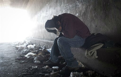 In this photo taken June 22, 2011, a homeless tries to rest inside a Tijuana River canal tunnel, in Tijuana, Mexico. During the day, deportees who find themselves in Tijuana look for work and flee Mexican police, who will jail them for not having papers, just like in the U.S. At night they take refuge in the canals, beneath bridges or in shacks, among drug addicts and people with mental health problems; a few feet from the rusty barrier that separates the country of their birth from the country where they worked years for a better life.  &#40;AP Photo&#47;Alejandro Cossio&#41; <span class=meta>(AP Photo&#47; Alejandro Cossio)</span>