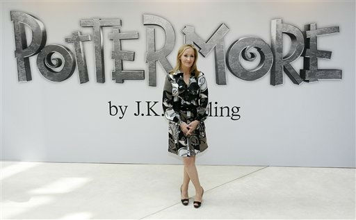 "<div class=""meta ""><span class=""caption-text "">British author J.K. Rowling poses for photographers as she announces her new website project Pottermore at the Victoria and Albert Museum in London, Thursday, June 23, 2011.  For the Pottermore project Rowling has written new material about the characters, places and objects in the Harry Potter stories. (AP Photo/Akira Suemori) (AP Photo/ Akira Suemori)</span></div>"