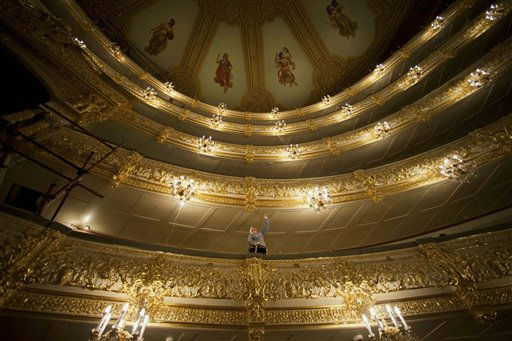 A restorer adds the final touches on the ceiling of a balcony of the big hall of the Bolshoi Theatre is seen in Moscow,  Russia, Thursday, June 23, 2011, during a press tour organized by restorers. The historic building of the theater is expected to reopen in the fall of 2011 after a long reconstruction. &#40;AP Photo&#47;Alexander Zemlianichenko&#41; <span class=meta>(AP Photo&#47; Alexander Zemlianichenko)</span>