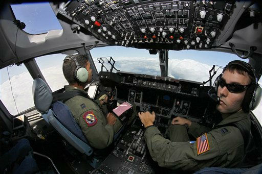 Captain Brandon Brown, left, and Captain Drew Marino of U.S. Air Force 15th Airlist Squadron of Charleston AFB, South Carolina, pilot a Boeing C-17 Globemaster III during a demonstration flight at the 49th Paris Air Show above le Bourget airport, east of Paris, Thursday June 23, 2011. &#40;AP Photo&#47;Francois Mori&#41; <span class=meta>(AP Photo&#47; Francois Mori)</span>