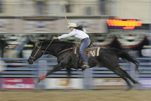 Jetta Abplanalp of Ogden, Utah pushes her horse to go faster during a barrel racing event at the Reno Rodeo, Thursday, June 23, 2011, in Reno, Nev. The rodeo, which kicked off June 16, 2011, at the Reno-Sparks Livestock Events Center will continue through June 25, 2011. &#40;AP Photo&#47;Kevin Clifford&#41;. <span class=meta>(AP Photo&#47; Kevin Clifford)</span>