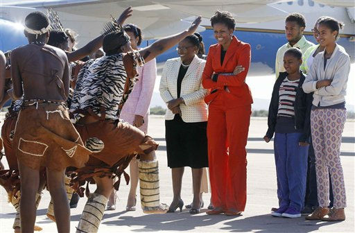 "<div class=""meta ""><span class=""caption-text "">U.S. first lady Michelle Obama with daughters Sasha, 2nd right,  and Malia, right,  are welcomed by traditional dancers as they arrive in Gaborone, Botswana, Friday, June 24, 2011. (AP Photo/Charles Dharapak, Pool) (AP Photo/ Charles Dharapak)</span></div>"