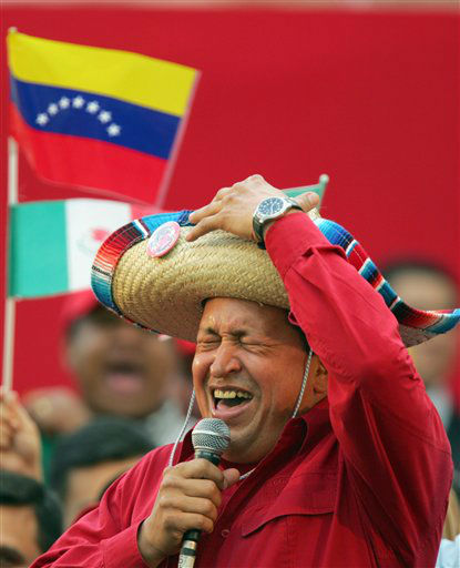 FILE - In this Nov. 19, 2005 file photo, Venezuela&#39;s President Hugo Chavez wears a Mexican sombrero as he sings a Mexican ranchera song at a rally in Caracas, Venezuela.  Venezuela&#39;s Vice President Nicolas Maduro announced on Tuesday, March 5, 2013 that Chavez has died.  Chavez, 58, was first diagnosed with cancer in June 2011.  &#40;AP Photo&#47;Fernando Llano, File&#41; <span class=meta>(AP Photo&#47; Fernando Llano)</span>