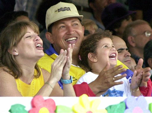 "<div class=""meta ""><span class=""caption-text "">FILE - In this July 15, 2001 file photo, Venezuela's President Hugo Chavez, center, his wife Marisabel with their daughter Rosa Ines watch a parade on Children's Day in Caracas, Venezuela.  Venezuela's Vice President Nicolas Maduro announced on Tuesday, March 5, 2013 that Chavez has died. Chavez, 58, was first diagnosed with cancer in June 2011.  (AP Photo/Ivan Gonzalez, File) (AP Photo/ Ivan Gonzalez)</span></div>"