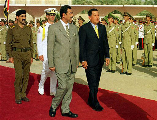 FILE - In this Aug. 11, 2000 file photo, Venezuela&#39;s President Hugo Chavez, front right, walks with Iraqi&#39;s President Saddam Hussein at Saddam airport in Baghdad, Iraq. Chavez, the first national leader to visit Iraq since the Gulf War in 1991, was leaving the country after a short visit as part of a tour of OPEC countries. Venezuela&#39;s Vice President Nicolas Maduro announced on Tuesday, March 5, 2013 that Chavez has died.  Chavez, 58, was first diagnosed with cancer in June 2011. &#40;AP Photo&#47;INA, Pool, File&#41; <span class=meta>(AP Photo&#47; Uncredited)</span>