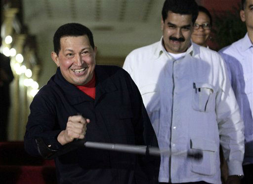 FILE - In this June 2, 2011 file photo, Venezuela&#39;s President Hugo Chavez, left, holds a crutch as he welcomes Brazil&#39;s former President Luiz Inacio Lula da Silva, not in picture, at Miraflores presidential palace in Caracas, Venezuela. Venezuela&#39;s Vice President Nicolas Maduro announced on Tuesday, March 5, 2013 that Chavez has died.  Chavez, 58, was first diagnosed with cancer in June 2011.  &#40;AP Photo&#47;Ariana Cubillos, File&#41; <span class=meta>(AP Photo&#47; Ariana Cubillos)</span>