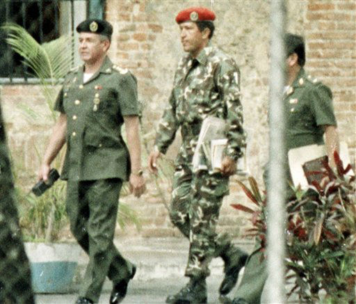 "<div class=""meta ""><span class=""caption-text "">FILE - In this Feb. 5, 1992 file photo, paratroop commander Hugo Chavez, center, is escorted by military intelligence officers after being arrested for trying to overthrow Venezuela's government in a coup. Venezuela's Vice President Nicolas Maduro announced on Tuesday, March 5, 2013 that Chavez has died.  Chavez, 58, was first diagnosed with cancer in June 2011.  (AP Photo/Andres Leighton, File) (AP Photo/ ANDRES LEIGHTON)</span></div>"