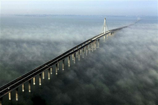 This photo taken Wednesday, June 29, 2011 released by China&#39;s Xinhua news agency shows the Jiaozhou Bay Bridge in Qingdao, east China&#39;s Shandong Province. China opened Thursday, June 30, 2011, the world&#39;s longest cross-sea bridge, which is 42 kilometers &#40;26 miles&#41; long and links China&#39;s eastern port city of Qingdao to an offshore island, Huangdao. &#40;AP Photo&#47;Xinhua, Yan Runbo&#41; NO SALES <span class=meta>(AP Photo&#47; Yan Runbo)</span>