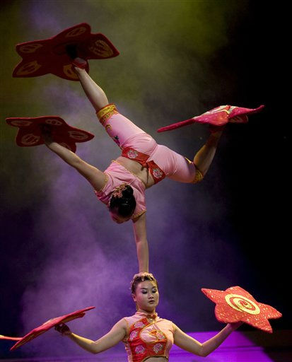 "<div class=""meta image-caption""><div class=""origin-logo origin-image ""><span></span></div><span class=""caption-text"">Chengdu Circus' acrobats perform on stage in Bogota, Colombia,Thursday, June 30, 2011. (AP Photo/William Fernando Martinez) (AP Photo/ William Fernando Martinez)</span></div>"