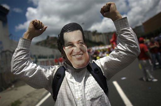 "<div class=""meta ""><span class=""caption-text "">A man wears a mask in the likeness of Venezuela's President Hugo Chavez during a march in Caracas, Venezuela, Sunday July 3, 2011. Thousands of Venezuelans marched celebrating the country's bicentennial and also to show support for their president, who remains in Cuba recovering from surgery. (AP Photo/Ariana Cubillos) (AP Photo/ Ariana Cubillos)</span></div>"