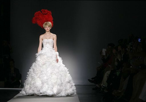 "<div class=""meta image-caption""><div class=""origin-logo origin-image ""><span></span></div><span class=""caption-text"">A model wears a creation by Christophe Josse for the Fall-Winter 2011-2012 Haute Couture fashion collection presented in Paris, Monday, July 4, 2011. (AP Photo/Francois Mori) (AP Photo/ Francois Mori)</span></div>"