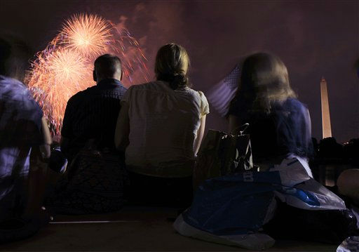 A family watches  from the Jefferson Memorial as fireworks explode over Washington Monday, July 4, 2011, during the annual Fourth of July display. &#40;AP Photo&#47;Cliff Owen&#41; <span class=meta>(AP Photo&#47; Cliff Owen)</span>