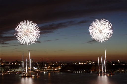 Fireworks are launched from barges in the Hudson River in New York, Monday, July 4, 2011.  &#40;AP Photo&#47;Seth Wenig&#41; <span class=meta>(AP Photo&#47; Seth Wenig)</span>