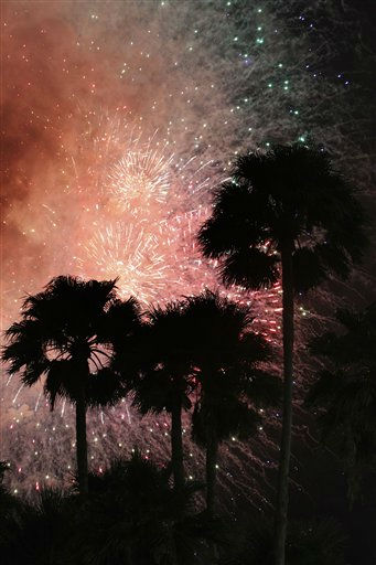 Palm trees are silhouetted during a fireworks display after a baseball game between the Florida Marlins and the Philadelphia Phillies, Monday, July 4, 2011, in Miami. The Phillies defeated the Marlins 1-0. &#40;AP Photo&#47;Wilfredo Lee&#41; <span class=meta>(AP Photo&#47; Wilfredo Lee)</span>