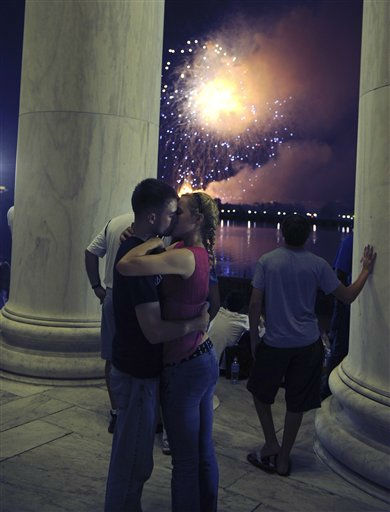 "<div class=""meta ""><span class=""caption-text "">U.S. Marines Jenna Ahles, 20, of La Crosse, Wis., right, and Jack Eubanks, 25, of Kennesaw, Ga., kiss while fireworks explode over Washington while viewing from the Jefferson Memorial, Monday, July 4, 2011. (AP Photo/Cliff Owen) (AP Photo/ Cliff Owen)</span></div>"